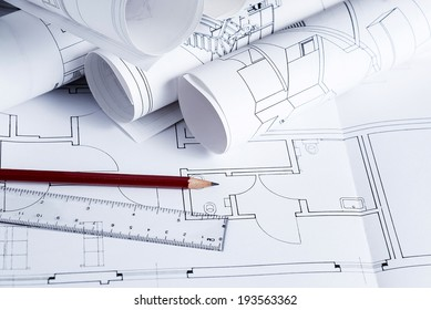 Architecture blueprints with pencil and ruler