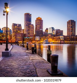 The architecture of Boston in Massachusetts, USA at Boston Harbor and Financial District at night.