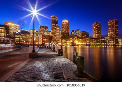 The architecture of Boston in Massachusetts, USA at night with its mix of contemporary and historic buildings at Boston Harbor and Financial District.