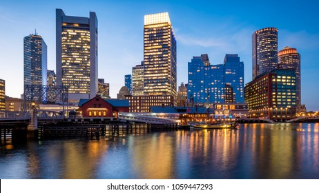 The architecture of Boston in Massachusetts, USA at night with its mix of contemporary and historic buildings seen from the Fan Pier.