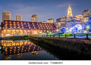The architecture of Boston in Massachusetts, USA at night showcasing the Boston Harbor and Financial District with its mix of contemporary and historic buildings.