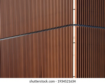 architecture of brown aluminum line wall