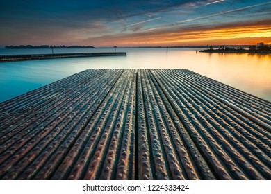 Architecture built jetty on the water with perspective and calm water at sunny sunset