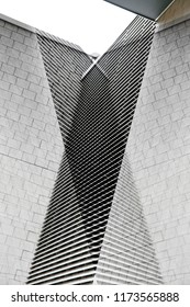 Architecture collage photo of tiled and louvered walls of modern buildings. Abstract black and white architectural background with angular structure.