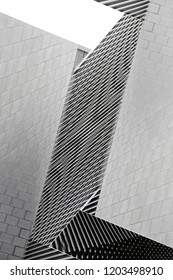 Architecture collage photo. Tiled and louvered walls of modern buildings. Abstract black and white architectural background with geometric structure.