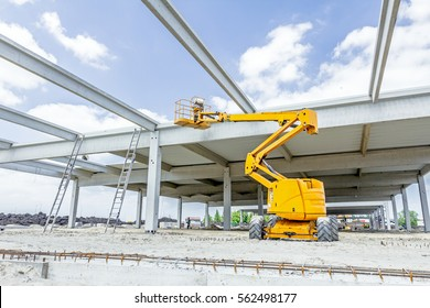 Architecture concept, concrete structure girders, ladders and cherry picker to the sky reaching for the higher place.