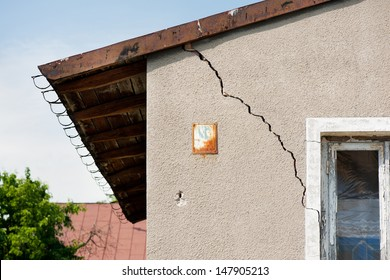 Architecture detail of damaged house dilapidated old building wall in Poland. Private abandoned home fall to ruin. Sunny day, horizontal orientation, nobody.