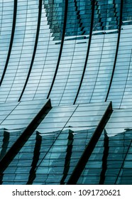 Architecture detail of modern building, glass facade with reflections