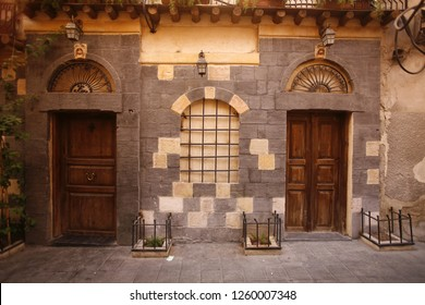 the architecture of Doors and Houses in the market or souq in the old town in the city of Damaskus in Syria in the middle east,       Syria, Damascus, April, 2009