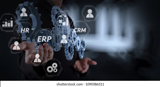 Architecture of ERP (Enterprise Resource Planning) system with connections between business intelligence (BI), production, CRM modules and HR diagram.businessman hand showing gear to success concept.