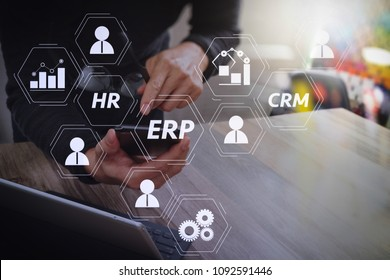 Architecture of ERP (Enterprise Resource Planning) system with connections between business intelligence (BI), production, CRM modules and HR diagram.Businessman hand using mobile payments online.