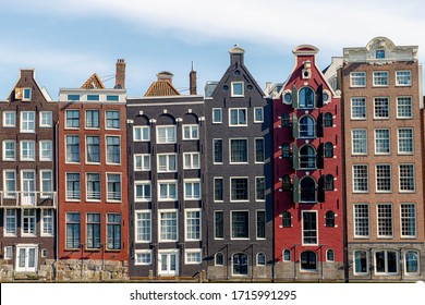 Architecture features traditional houses, Typical dutch house at Damrak canal,  An avenue running between Amsterdam Centraal in the north and Dam Square in the south, Netherlands.