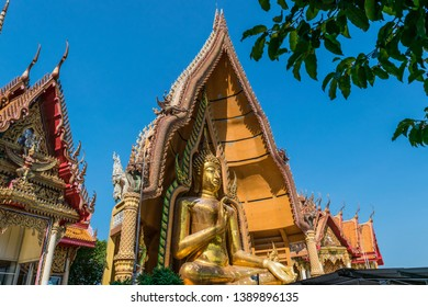 Architecture golden church with big buddha and pagoda in Wat Tham Sua