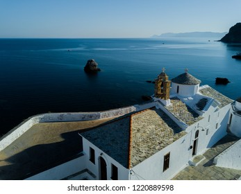 Architecture of the Greek Islands in the Aegean Sea - Sunrise at the Island of Skopelos, Aerial Drone Photo of a Typical White Greek Orthodox Church