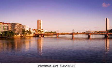 the architecture of the historic city of Recife in Pernambuco, Brazil at sunset by the Capibaribe river.