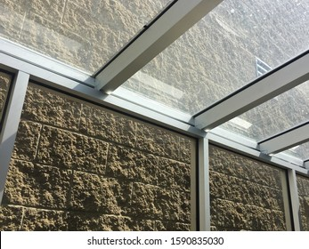 Architecture and interior design of glass terrace building with natural stone wall tiles