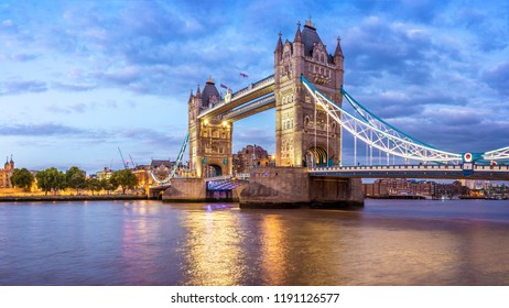 The architecture of London in the UK showcasing the Tower Bridge over the Thames river at sunset.
