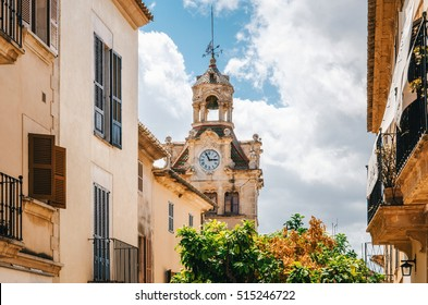 Architecture of Majorca. The tower with big clock of City town hall in Old Town of Alcudia, Mallorca, Balearic island, Spain
