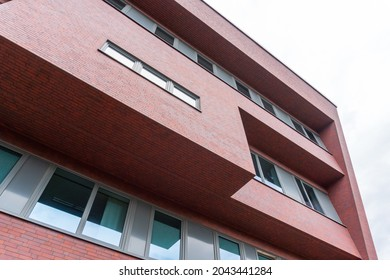 Architecture modern facade made of red bricks