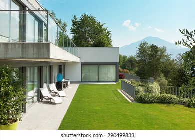 Architecture, modern white house with garden, outdoors