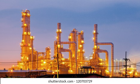 Architecture of Oil Refinery Plant with distillation tower with Sunrise Twilight
