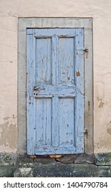 Architecture: Old blue wooden cassette door of a historical building in Eastern Germany