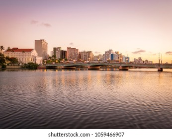 the architecture of Recife in Pernambuco, Brazil with its mix of contemporary and historic buildings at sunset by the Capibaribe river.