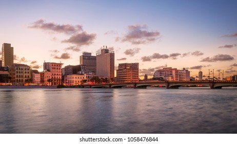 the architecture or Recife in Pernambuco, Brazil at sunset by the Capibaribe river.