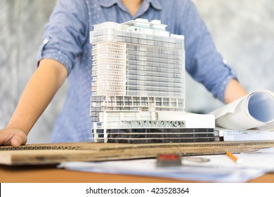 architecture show her model Simulate on blueprint architectural concept, soft focus