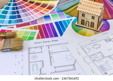 Architecture sketches with color swatches on table