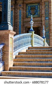 The architecture of Spanish Square (Plaza de Espana) in Seville, Andalusia, Spain.  Columns and balustrades of bridges are decorated by typical Andalusian old ceramic balustrade in Spanish square.