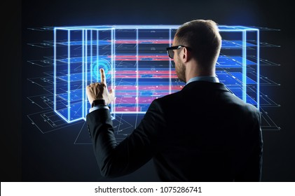 architecture, technology and construction concept - businessman with virtual building blueprint projection on screen