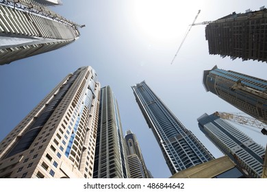 Architecture theme and concept. Corporate buildings in perspective. Big construction site. Industrial, construction and development of skyscrapers  theme. Construction concept.
