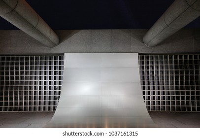 Architecture with various shapes, structures, arches, columns with grates and indirect lighting exterior facade grey background texture