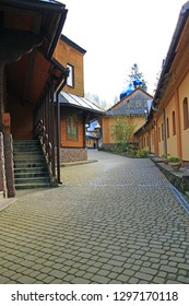 Architecture and walkway on territory of monastery Manyava Skete of Exaltation of Holy Cross in Western Ukraine. Religious place