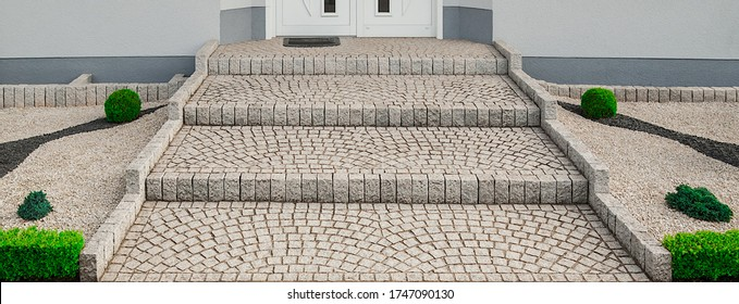 Architecture wide outside staircase made of granite pavement in the front yard