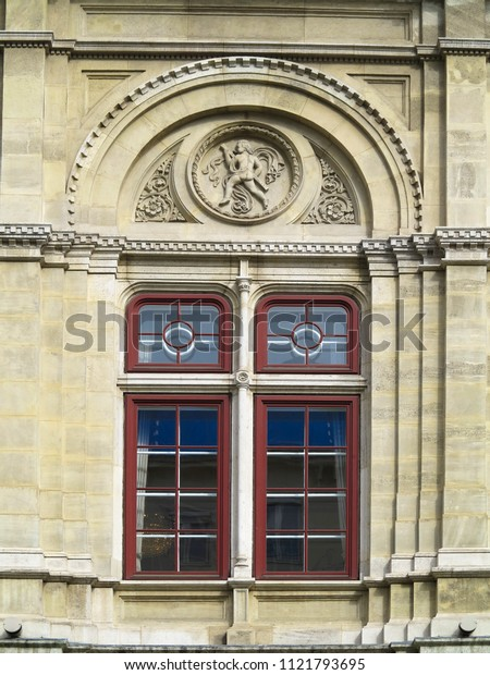 Architecture and windows of ancient renaissance style classical building european facade