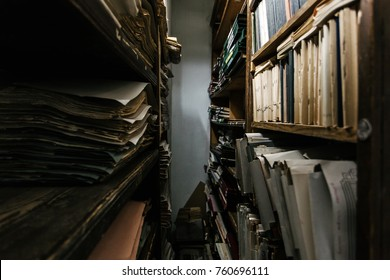 Archival documents old vintage files folder  on the shelves  in a storage room
