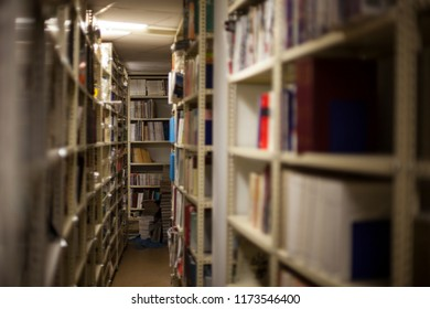 Archive store. Files, documents, magazines. Library, books.