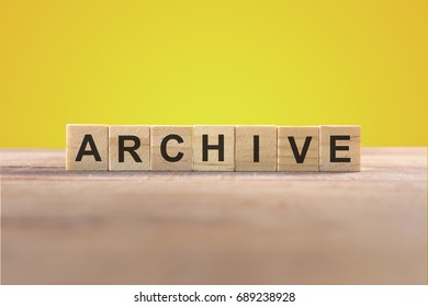 Archive Word In Wooden Cube With Yellow Background