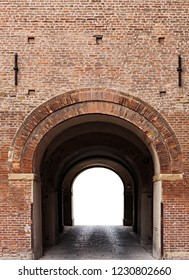 Archway in the ancient brick fortress wall isolated on white background