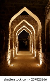 Archway inside Bahrain fort at night