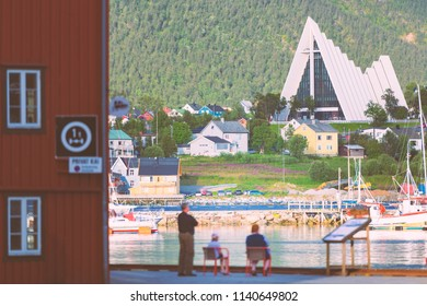 Arctic cathedral in Tromso, Norway, Scandinavia, Europe. Architecture and religion. People looking at city view.