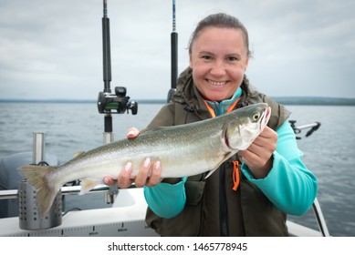 Arctic char fishing trophy in female hands