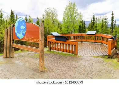 ARCTIC CIRCLE, ALASKA, USA - MAY 23, 2017: The Arctic Circle Board at the Dalton Highway between Fairbanks and Coldfoot. This sign marks the beginning of the arctic circle in northern Alaska.