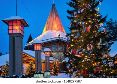 Arctic Circle street lamps at Santa Office of Santa Claus Village, Rovaniemi, Lapland, Finland, in winter. Late in the evening
