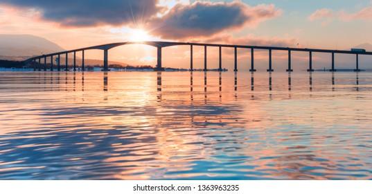 Arctic city of Tromso with bridge at sunset -Tromso, Norway