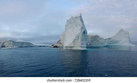 Arctic Icebergs Greenland in the arctic sea. You can easily see that iceberg is over the water surface, and below the water surface. Sometimes unbelievable that 90% of an iceberg is under water.