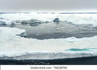 Arctic Icebers on Arctic Ocean in Greenland