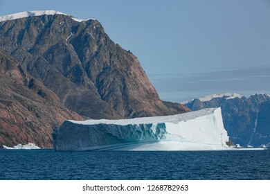 arctic landscape with floating iceberg in  the  fjords of East Greenland in summer